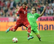 Bayern Munich's striker Mario Mandzukic and Wolfsburg's defender Emanuel Pogatetz fight for the ball during their German first division Bundesliga football match in Munich, southern Germany. Bayern won 3-0