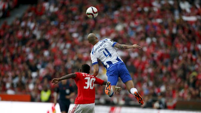 Benfica's Anderson Talisca fights for the ball with Porto's Maicon Roque during their Portuguese premier league soccer match at Luz stadium in Lisbon