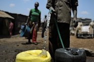 A man collects water in jerrycans to sell in March 2012 in the Mathare slum of Nairobi. he world's diminishing water supply carries serious security, development and social risks, and could adversely affect global health, energy stores and food supplies, a a panel of experts has said