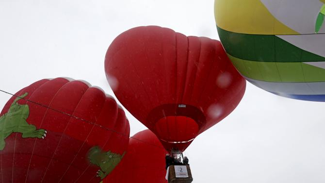 "Hot air balloons take off during the ""Love Cup 2016"" festival on Valentine's Day in Jekabpils, Latvia"