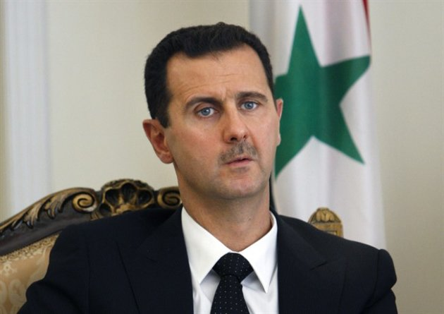 FILE - This Wednesday, Aug. 19, 2009 file photo shows Syrian President Bashar Assad, seen, during a meeting with his Iranian counterpart Mahmoud Ahmadinejad, unseen, at the presidency in Tehran, Iran.