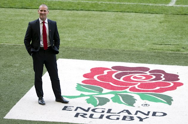 Stuart Lancaster, the new head coach of England's rugby union team poses for photographers before a press conference in Twickenham stadium in south west London on March 29, 2012.  Lancaster has been c