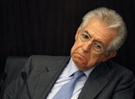 Italy&#39;s Prime Minister Monti reacts during a news conference about the labour reforms in Rome