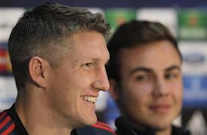 Bayern Munich's Bastian Schweinsteiger and Mario Gotze attend a news conference in Plzen