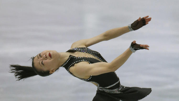 Akiko Suzuki of Japan performs during the women short program event at the ISU Four Continents Figure Skating Championships in Osaka, western Japan, Saturday, Feb. 9, 2013. (AP Photo/Shizuo Kambayashi)