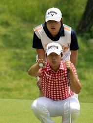South Korea's Lee Sang-hee (front) and his caddie eyeing up a putt during the first round of the Volvik Hildesheim Open golf tournament at the Hildesheim Country Club in Jecheon. South Korean rookie Ma Soo-Kil and compatriot Lee put the hosts on top as they shared the first round lead at the inaugural Volvik Hildesheim Open J Golf Series