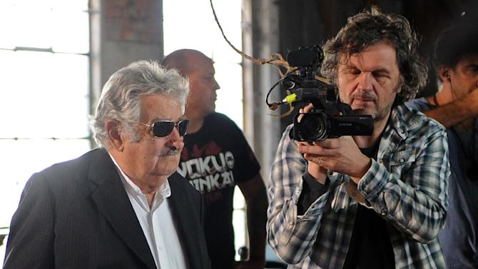 Former Uruguayan President José Mujica (L) is recorded by award-winning Serbian filmmaker Emir Kusturica during the inauguration of the Agrarian School of Rincon del Cerro, in Montevideo department on March 5, 2015