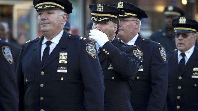 Police officers arrive for the wake for NYPD officer Rafael Ramos at Christ Tabernacle Church in the Queens borough of New York