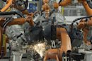 Welding robots are seen in a production line of the Golf VII car at the plant of German carmaker Volkswagen in Wolfsburg