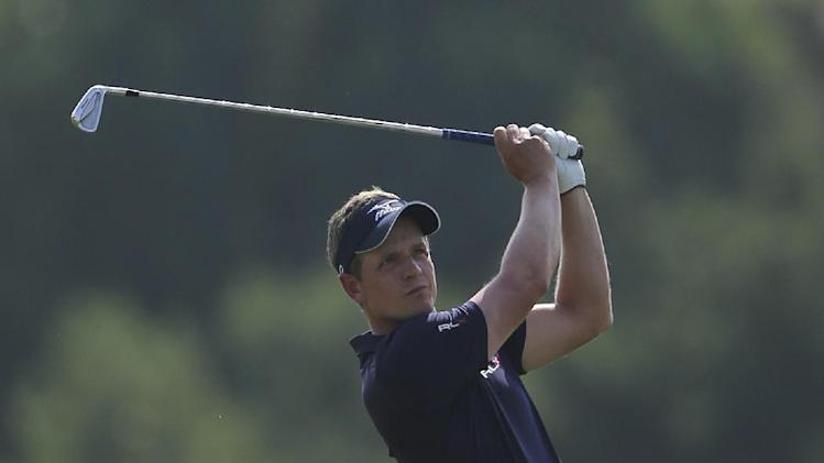 Luke Donald of England plays a shot on the 3rd hole during the final round of DP World Golf Championship in Dubai, United Arab Emirates, Sunday Nov. 25, 2012. (AP Photo/Kamran Jebreili)