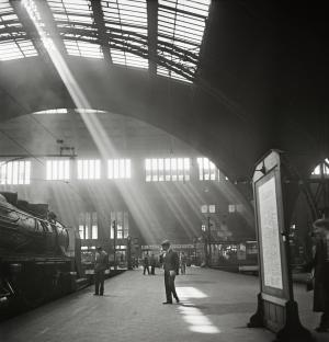 In this photo from the late 1920s to early 1930s provided by the International Center of Photography, sunlight streams into a Berlin railway station. This image is part of a large archive of Roman Vishniac's work that the United States Holocaust Memorial Museum has begun to digitally share with the International Center of Photography. Vishniac was a Russian-born Jew who immigrated to Berlin in 1920. As an avid photographer, he documented the ominous rise of Nazi power and its effect on everyday Jewish life in Central and Eastern Europe. (AP Photo/International Center of Photography, United States Holocaust Memorial Museum, Roman Vishniac) MANDATORY CREDIT: INTERNATIONAL CENTER OF PHOTOGRAPHY, UNITED STATES HOLOCAUST MEMORIAL MUSEUM, ROMAN VISHNIAC