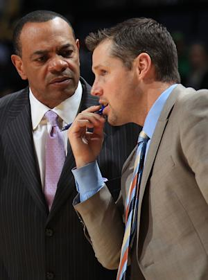 In this photo taken Dec. 8, 2012, Memphis Grizzlies assistant coach David Joerger, right, talks with head coach Lionel Hollins during an NBA basketball game in Memphis, Tenn. The Grizzlies are negotiating with Joerger to become the team's new head coach, said a person familiar with the situation. The person spoke to The Associated Press Tuesday, June 25, 2013, on condition of anonymity because the final deal hasn't been reached yet. (AP Photo/The Commercial Appeal, Nikki Boertman, File)