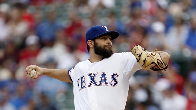 Texas Rangers starting pitcher Nick Martinez (22) works against the Boston Red Sox during the first inning of a baseball game, Thursday, May 28, 2015, in Arlington, Texas. (AP Photo/Brandon Wade)