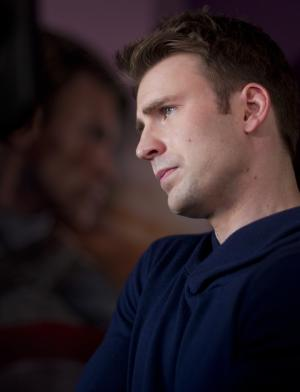 """Actor Chris Evans, who stars in Paramount Pictures and Marvel's """"Captain America: The First Avenger,"""" speaks to journalists before a showing of the movie during Comic Con Thursday, July 21, 2011, in San Diego. (AP Photo/Gregory Bull)"""