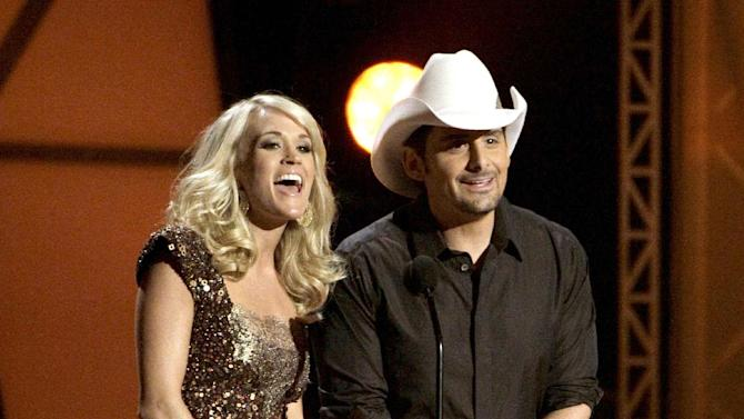 """FILE - In this Nov. 9, 2011 file photo hosts Carrie Underwood, left, and Brad Paisley speak during the 45th Annual CMA Awards in Nashville, Tenn. The former """"American Idol"""" winner's latest album """"Blown Away"""" was a multi-week No. 1 on the country albums chart, she's in the midst of an arena tour and she also is up for female vocalist of the year at the CMA Awards, on Thursday, Nov. 1, 2012, airing live on ABC at 8 p.m. EDT from Nashville's Bridgestone Arena. (AP Photo/Mark Humphrey, File)"""