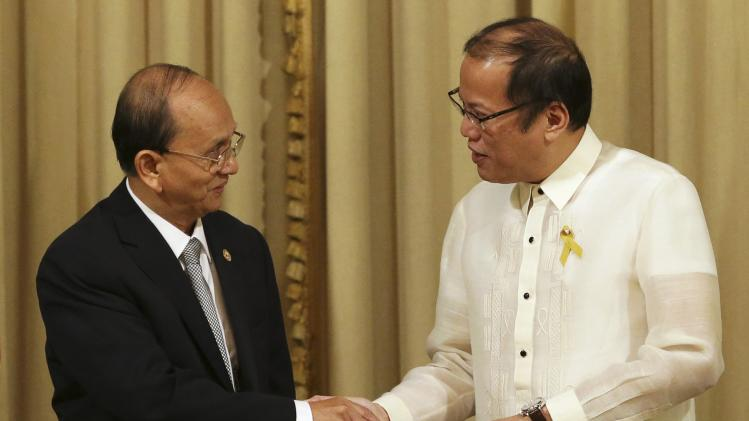 Philippine President Aquino shakes hands with Myanmar's President Thein Sein during visit at Malacanang Presidential Palace in Manila