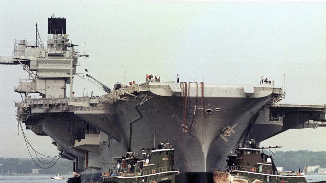 FILE - In this Aug. 7, 1998 file photo, the U.S.S. Saratoga aircraft carrier is guided into Pier One of Coddington Cove in Middletown, R.I., by tugs after a five-day journey from the Philadelphia Naval Yard. The 1,039 foot aircraft carrier was decommissioned in 1994 after 42 years of service in the Navy. The carrier is supposed to be towed to Texas to be dismantled. But a family of Peregrine falcons made it their home and it can't be moved until the fledglings are ready to leave the nest, delaying the carrier's final trip, likely in mid-August, 2014. (AP Photo/Matt York, File)