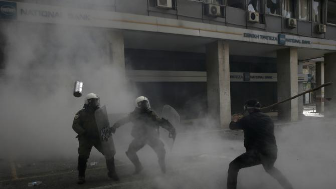Greek farmer from the region of Crete clash with police during a protest against planned pension reforms outside the Agriculture ministry in Athens