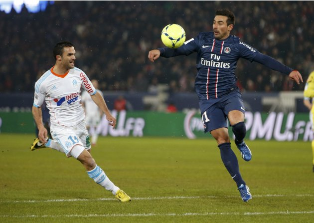 Paris Saint-Germain's Lavezzi challenges Olympic Marseille's Morel during their French Ligue 1 soccer match at Parc des Princes stadium in Paris