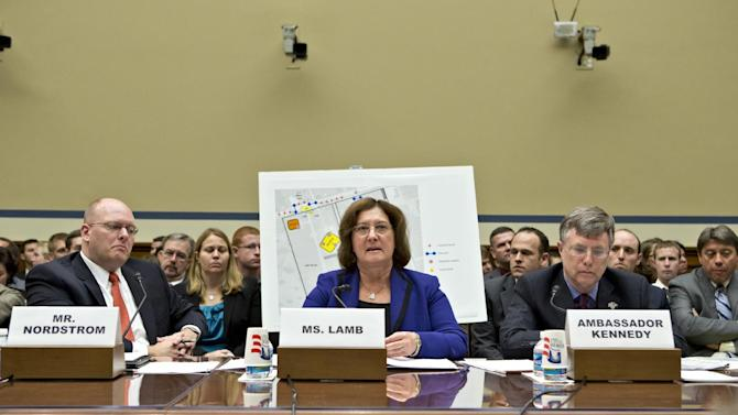 Charlene Lamb, deputy assistant secretary for international programs at the State Department's Bureau of Diplomat Security, center, testifies on Capitol Hill in Washington, Wednesday, Oct. 10, 2012, before the House Oversight and Government Reform Committee hearing investigating the Sept. 11, 2012 attack on the American consulate in Benghazi, Libya, that resulted in the death of U.S. Ambassador Christopher Stevens and other Americans. She is joined by Eric Nordstrom, left, a regional security officer with the State Department, and Amb. Patrick Kennedy, right, under secretary for management at the State Department.  (AP Photo/J. Scott Applewhite)