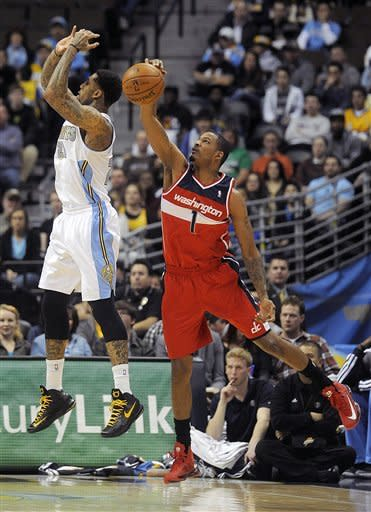 Wizards end road skid with win against Nuggets