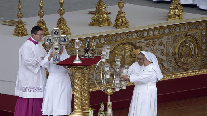 The relics Maria Guadalupe Garcia Zavala, of Mexico, are carried by nuns on the altar after being blessed by Pope Francis during a canonization mass in St. Peter's Square at the Vatican, Sunday, May 12, 2013. (AP Photo/Gregorio Borgia)