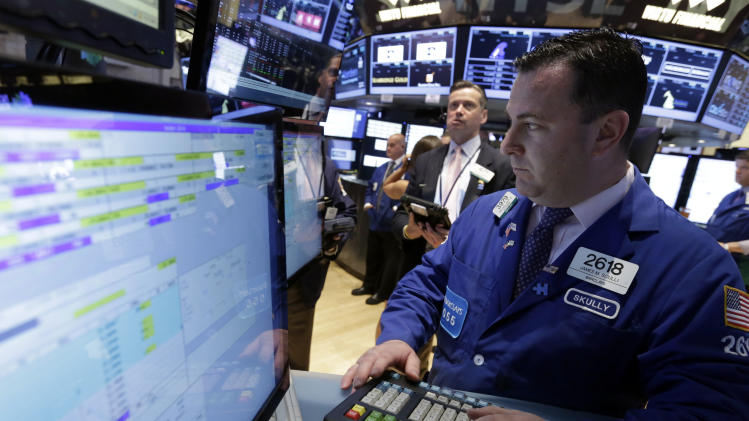 Specialist James Sciulli, right, works at his post on the floor of the New York Stock Exchange Wednesday, June 19, 2013. Stocks edged lower in early trading on Wall Street Wednesday as investors waited for word from the Federal Reserve. (AP Photo/Richard Drew)