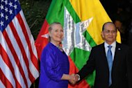 <p>US Secretary of State Hillary Clinton (L) shakes hands with Myanmar President Thein Sein in Siem Reap on July 13, 2012. The United States has opened talks with Myanmar and recently announced an easing of sanctions in return for movement toward democracy.</p>