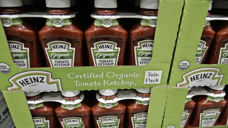 FILE - In this Feb. 22, 2009, file photo, bottles of Heinz organic tomato ketchup are on display inside Costco in Mountain View, Calif. The organic industry is gaining clout on Capitol Hill, prompted by rising consumer demand and its entry into traditional farm states. But that isn't going over well with everyone in Congress. Tensions between conventional and organic agriculture boiled over this week during a late-night House Agriculture Committee debate on a sweeping farm bill that has for decades propped up traditional crops and largely ignored organics. (AP Photo/Paul Sakuma)