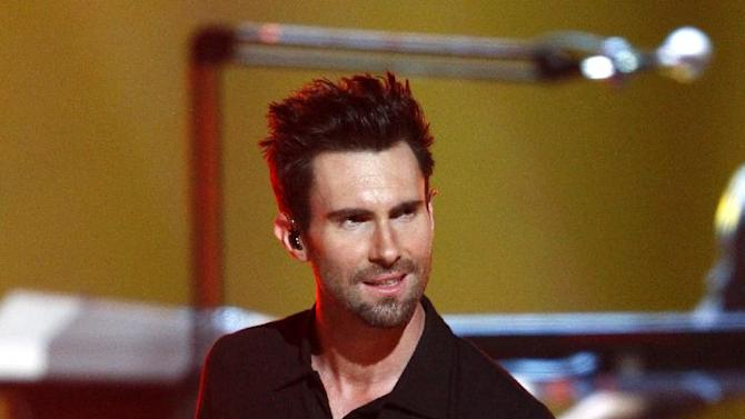 Adam Levine, of the musical group Maroon 5, performs at the Grammy Nominations Concert Live! at Bridgestone Arena on Wednesday, Dec. 5, 2012, in Nashville, Tenn. (Photo by Wade Payne/Invision/AP)