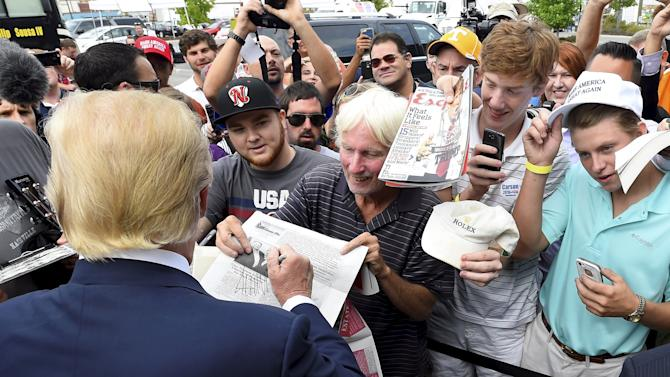 Republican presidential candidate Donald Trump signs autographs during the National Federation of Republican Assemblies at Rocketown in Nashville, Tennessee