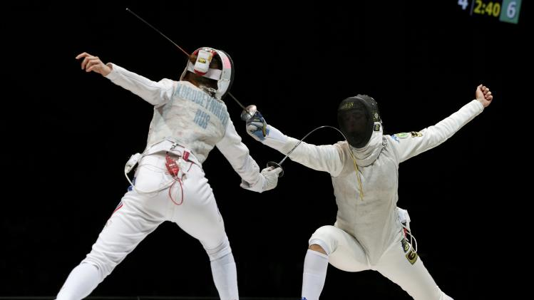 Korobeynikova of Russia competes against Batini of Italy in the women's team foil final match at the World Fencing Championships in Kazan