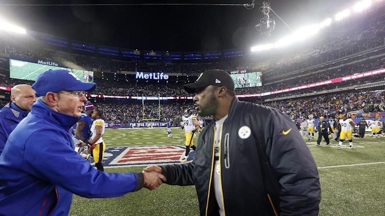 New York Giants head coach Tom Coughlin, left, shakes hands with Pittsburgh Steelers head coach Mike Tomlin, right, after an NFL football game, Sunday, Nov. 4, 2012, in East Rutherford, N.J. The Steelers won 24-20. (AP Photo/Julio Cortez)