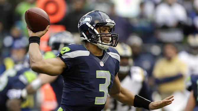 Seattle Seahawks quarterback Russell Wilson passes in the first half of an NFL football game against the St. Louis Rams, Sunday, Dec. 30, 2012, in Seattle. (AP Photo/Elaine Thompson)