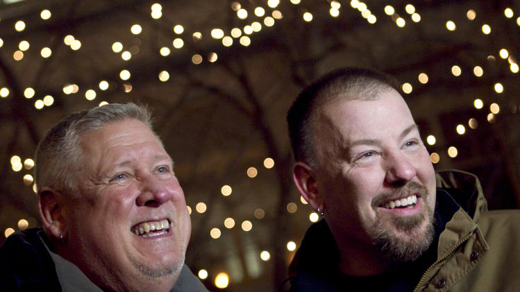 Michael Snell, left, and Steven Bridges speak to a reporter, Friday, Dec. 28, 2012, outside City Hall before obtaining a marriage license under the state's new law in Portland, Maine. Bridges and Snell held a commitment ceremony six years ago but made marriage official under state law with a simple ceremony early Saturday as Maine's new law permitting same-sex marriage took effect at the stroke of midnight. (AP Photo/Robert F. Bukaty)
