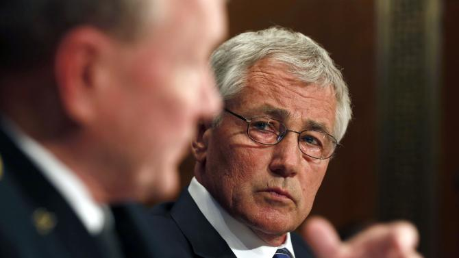 U.S. Secretary of Defense Hagel listens to Chairman of the Joint Chiefs Gen. Dempsey during the defense subcommittee of the Senate Appropriations Committee on Capitol Hill in Washington