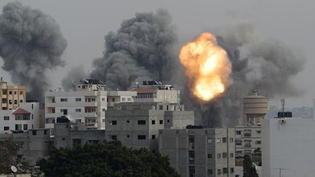 Smoke and explosion are seen during Israeli air strikes, witnessed by a Reuters photographer, in Gaza City (Reuters)