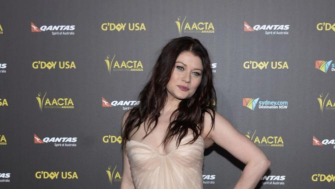 Actress Emilie de Ravin poses at the 2015 G'Day USA Los Angeles Gala honoring actor Chris Hemsworth with an Excellence in Film Award, at the Hollywood Palladium in Los Angeles, California