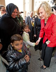 <p>In Cairo in March, Hillary Clinton greets the family of Khairy Ramadan Ali, who was killed in January 2011 during the Egyptian uprising. Clinton is scheduled in a new two-day visit to meet President Mohamed Morsi -- a senior member of the Muslim Brotherhood until he was sworn in last month -- and other top officials, as well as civil society groups, the official MENA news agency says.</p>