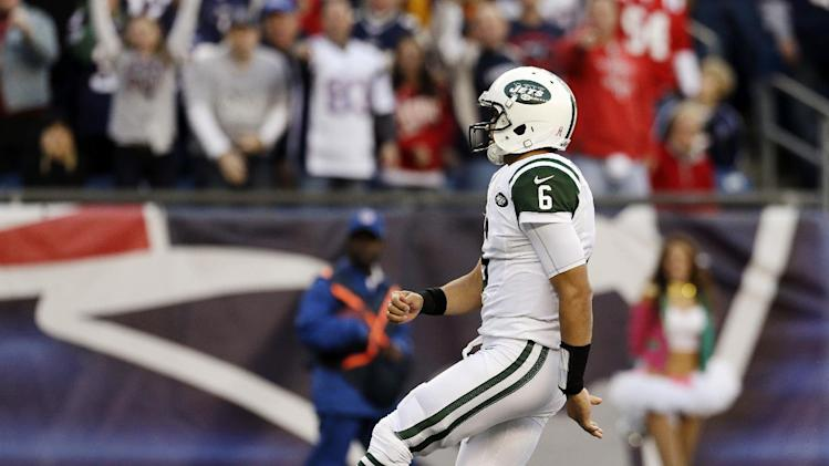 New York Jets quarterback Mark Sanchez follows through after kicking the ball out of the end zone for a safety in the second quarter of an NFL football game against the New England Patriots in Foxborough, Mass., Sunday, Oct. 21, 2012. (AP Photo/Elise Amendola)