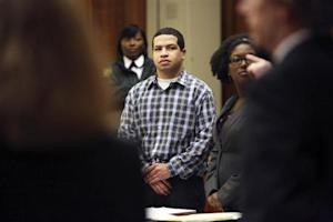 Eric Rivera, Jr. stands as the jury enters the courtroom during closing arguments of the Sean Taylor murder trial in Miami