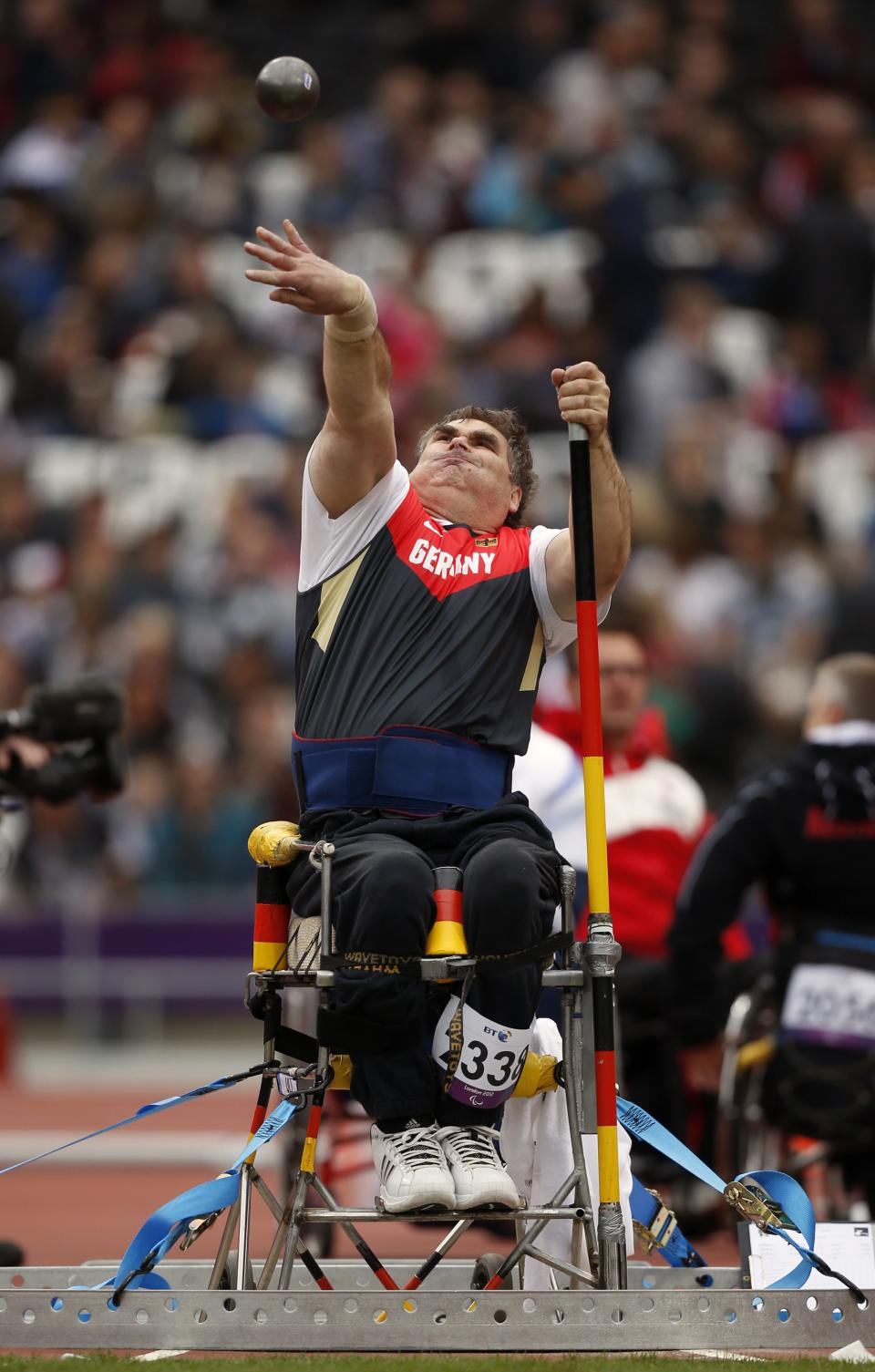 Germany's Ulrich Iser throws in the men's shot put F54/55/56 category during the athletics competition at the 2012 Paralympics, Saturday, Sept. 1, 2012, in London.  (AP Photo/Matt Dunham)