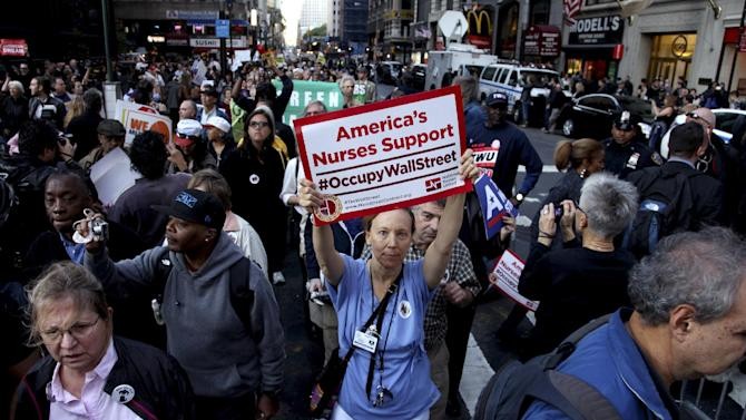 Nurse Margret Sweeney, center, and others join Occupy Wall Street during a march in Lower Manhattan Wednesday, Oct. 5, 2011 in New York. Unions gave a high-profile boost to the long-running protest against Wall Street and economic inequality Wednesday, with their members joining thousands of protesters in a lower Manhattan march. (AP Photo/Craig Ruttle)