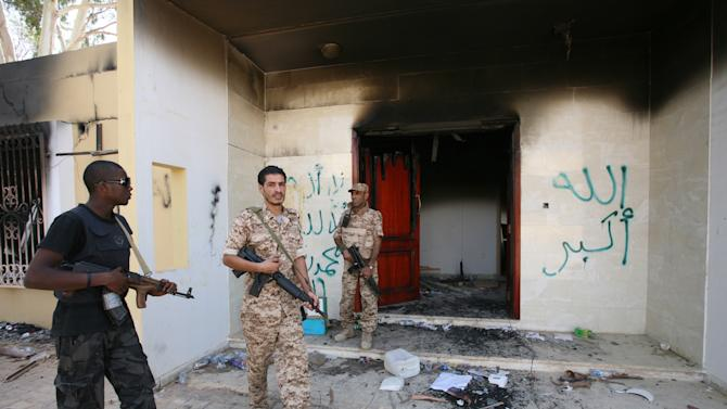 FILE - In this Friday, Sept. 14, 2012 file photo, Libyan military guards check one of the U.S. Consulate's burnt out buildings during a visit by Libyan President Mohammed el-Megarif, not shown, to the U.S. consulate in Benghazi, Libya to express sympathy for the death of the American ambassador, Chris Stevens and his colleagues in the deadly Sept. 11, 2012 attack on the consulate. (AP Photo/Mohammad Hannon, File)