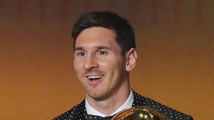 Argentina's Lionel Messi shows off the FIFA Men's World Player of the Year Award during the FIFA Ballon d'Or Gala 2013 held at the Kongresshaus in Zurich, Switzerland, Monday, Jan. 7, 2013. (AP Photo/Keystone, Steffen Schmidt)