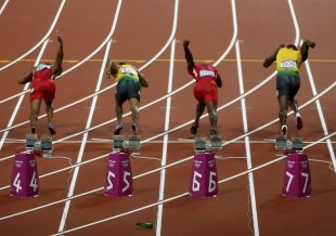 A beer bottle bounces on the track as competitors in the men's 100 meters final start off the blocks at the London 2012 Olympic Games August 5, 2012. ...