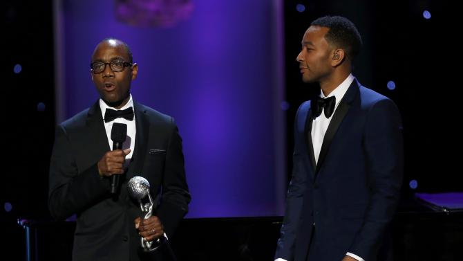 NAACP President Brooks presents the President's Award to musician Legend at the 47th NAACP Image Awards in Pasadena