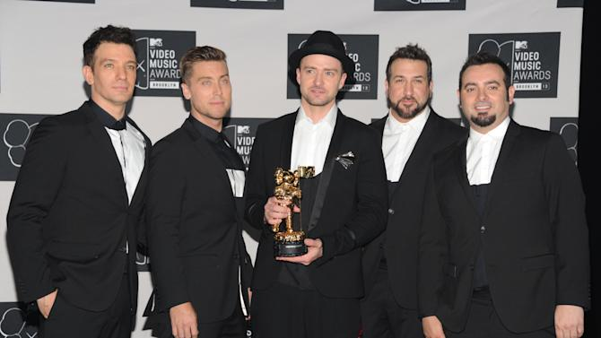 Bass nixes 'N Sync reunion; dishes on Miley Cyrus