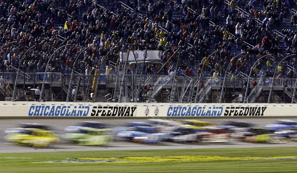 Drivers restart after being rain delayed during the NASCAR Sprint Cup series auto race at Chicagoland Speedway in Joliet, Ill., Sunday, Sept. 15, 2013. (AP Photo/Nam Y. Huh)