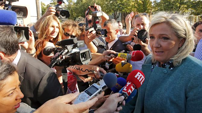 Marine Le Pen, leader of France's National Front political party, answers questions from the media during the National Front political party summer university in Marseille, France